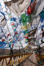 Prayer Flags On A Footbridge - Tibet