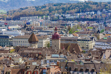 Aerial View Of The Red Tiled Roofs Of The Old Town Of Lucerne City, Wooden Chapel Bridge, Reuss River And Lake Lucerne From City Wall, Switzerland