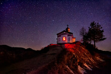 Small Chapel On The Hill In Rhodope Mountain Near Borovo Village. Bulgaria. Night Starry Sky, Blue Shining Space. Abstract Background With Stars, Cosmos.