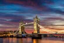 Tower Bridge Illuminated At Dusk, London, England