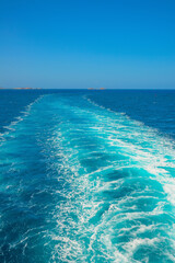 View of sea from a ship traveling to Greek islands in Cyclades at summer