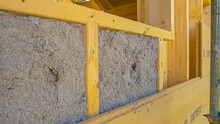 CLOSE UP: Ecofriendly Cellulose Insulation Fills Up A Frame On A Wooden Wall.