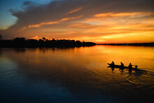 A Small Motorized Canoe On The Guaporé - Itenez River During Sunset, Ricardo Franco Village, Vale Do Guaporé Indigenous Land, Rondonia, Brazil, On The Border With Bolivia