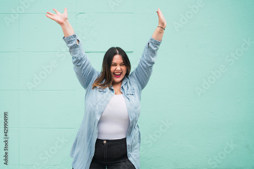 Fotografie, Obraz Young plus size woman celebrating victory.