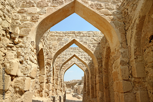 Fotografie, Tablou The Ancient Archways of Bahrain Fort or Qal'at al-Bahrain, an Iconic Historic Si