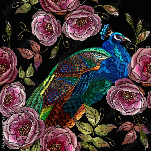 Billede på lærred Embroidery peacocks and wild roses flowers