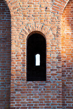 Shaped Window In Ancient Brick Wall. A Fragment Of Old Smolensk Kremlin Fortress.
