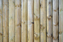 Close Up Of Wooden Fence With Vertical Timber Planks