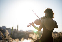 Young Woman Violinist Posing Playing On The Street During Sunset Close Up