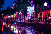 Amsterdam, The Netherlands, May 14 2018: Red Lights On The Canals Of The Amsterdam Red Light District
