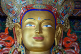 Colorful statue of Maitreya Buddha at Tibetan Buddhist Thiksey Monastery near mountain village Leh in ladakh region, north India