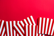 Cinema And Watching Movies Conccept Border Backgground. Red Strtiped Popcorn Buckets