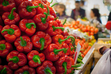 Closeup Shot Of A Pile Of Beautiful Red And Orange Sweet Peppers In The Market