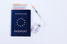 The Concept Of The EU Health Passport. Covid Passport Or Green Travel Certificate. Passport, Euro Tickets, Coronavirus Vaccination And Syringe. Necessity Of Vaccination To Travel Around The World.