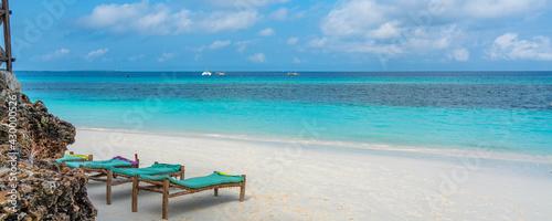 Obraz na plátně Tropical white beach with bench on Zanzibar island. Tanzania.