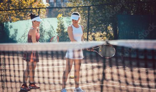 Fototapeta Tennis coach teaching woman in the game obraz