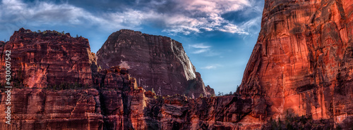Panoramic American landscape view of Mountains and Canyon. Dramatic Colorful Artistic Render. Taken in Zion National Park, Utah, United States. Nature Background Panorama