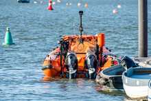 The Inflatable Orange Inshore Lifeboat Moored Up In Wells-Next-The-Sea Estuary On The North Norfolk Coast.