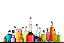 Various Transparent Old Antique Bottles With Colorful Liquids On White Background.  Alcohol, Medicine, Oil Or Cosmetic Bottles.