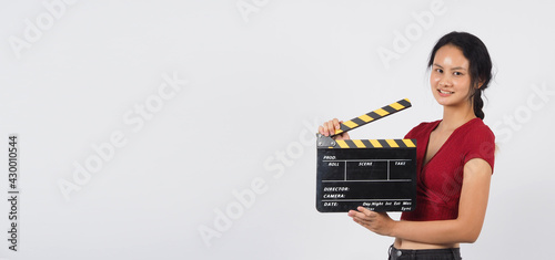 Fotografering Girl or woman hand's holding black clapper board or movie slate or slate ,use in video production ,film, cinema industry on white background