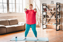 Plump Fat Young Woman In Sporty Clothes Doing Fitness Exercises At Home With Mat For Losing Weight And Burning Calories . Chubby Plus Size Woman Wants Good Shape And Body
