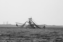 Shrimp Boat With Nets In Black And White