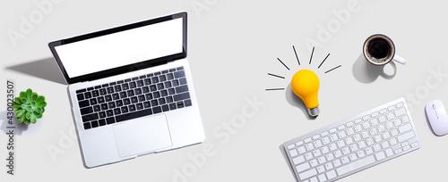 Fototapeta Computers with a light bulb obraz