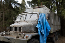 Old Retro And Vintage Army And Military Truck. Vehicle Is Corroded And Rusty. Shallow Focus.