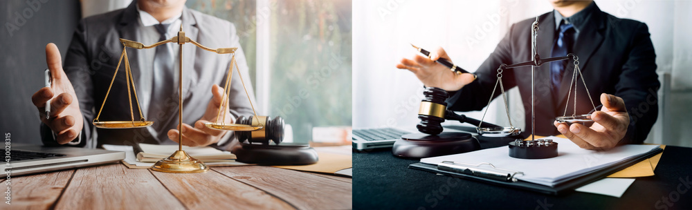 Fototapeta Close up of hand lawyer working signing contract paper with wooden gavel judge in the office. lawyer and law ,judiciary and legislature courtroom legal concept.