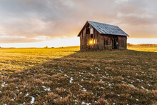 Old Barn On Arable Land In Sweden That Keeps Falling Apart With A Sunset That Radiates Through The House During The Month Of April
