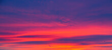 Vivid Saturated Beautiful Sunset Sky In Orange, Purple And Red Colors. Sunset Background