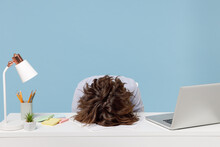Young Tired Exhausted Frustrated Secretary Employee Business Woman Wearing Casual Shirt Sit Work Sleep Laid Her Head Down On White Office Desk With Pc Laptop Isolated On Pastel Blue Background Studio.
