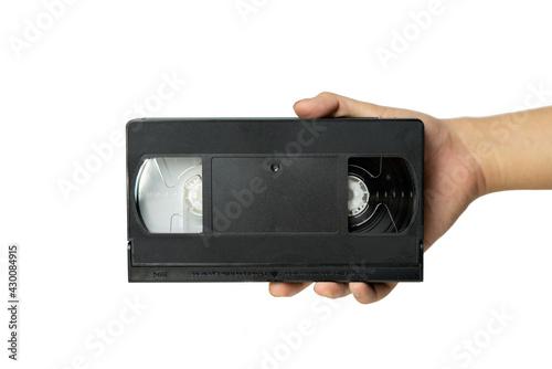 Fototapeta Video tape cassette VHS holding in hand. obraz na płótnie