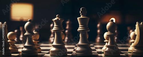 Vászonkép Chess pieces arranged on the chessboard