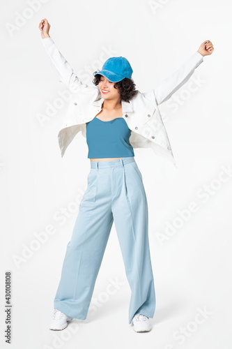 Fotografie, Obraz Happy woman posing in white jacket and blue outfit