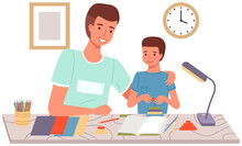 DIY Activity For Father And Son. Dad And Kid Spend Quality Time Together. Creative Family Pastime. Family Makes Paper Crafts, Glues And Cuts With Scissors. Parent With Child Spends Time Creatively