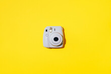 Vilnius, Lithuania - September 16, 2019: FUJIFILM INSTAX Mini Instant Film Camera On Yellow Background.