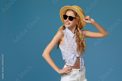Fototapeta beautiful little girl in summer hat and sunglasses
