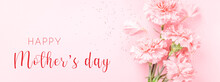 Banner With Pink Carnations On Pink Background With Happy Mother's Day Greeting.