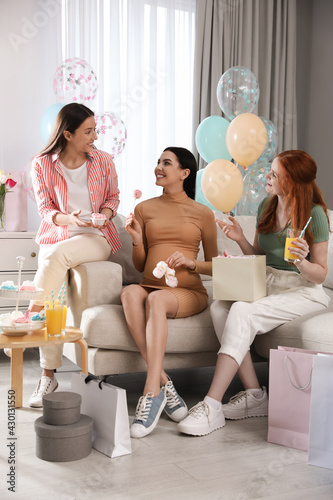 Happy pregnant woman spending time with friends at baby shower party - fototapety na wymiar