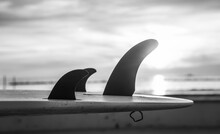 Details Of Surfboard Fins By The Sea At Sunset