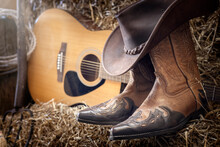 Country Music Festival Live Concert Or Rodeo With Cowboy Hat Guitar And Boots In Barn