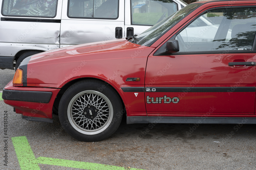 BARCELONA, SPAIN - Apr 23, 2021: Old red car parked on the street, it is a Volvo 440 2.0i Turbo