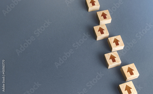 Fotografering Chain of blocks of unidirectional arrows