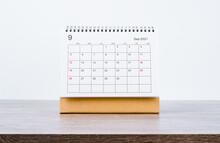 September Calendar 2021 On Wooden Table.