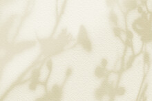 Flower Shadows On Light Yellow Pastel Color Wall.