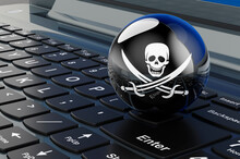 Piracy Flag On Laptop Keyboard. 3D Rendering