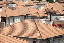 Modern Residential Complex With Red Tile Roofs And TV Satellite