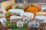 Fototapeta Dmuchawce - Wide variety of cheeses on platter
