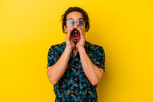 Young Caucasian Man Wearing Summer Clothes Isolated On Yellow Background Shouting Excited To Front.